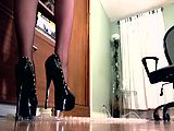 Sexy legs and stiletto heels trample bubble wrap