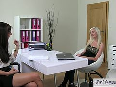 Blonde babe and female agent share dick in an office